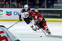 KELOWNA, BC - FEBRUARY 15: Alex Swetlikoff #17 of the Kelowna Rockets pursues Christoffer Sedoff #4 of the Red Deer Rebels as he skates with the puck at Prospera Place on February 15, 2020 in Kelowna, Canada. (Photo by Marissa Baecker/Shoot the Breeze)