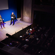 "CAt Picton-Phillipps and Peter Kennard introducing a film with Harold Pinter reading from his book ""War"". TEN, a benefit event for Stop the War at the Royal Court, London."