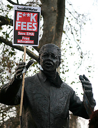 © under license to London News Pictures. 9/12/2010. Nelson Mandella's statue in Parliament Square. On the day that MPs vote on tuition fees, 1000s demonstrated in London against a proposed rise in fees and cuts in support. Photo credit should read Fuat Akyuz/London News Picture