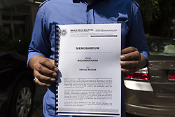 September 8, 2017 - Kuala Lumpur, MALAYSIA - Khairul Azwan Harun(41, politician) who Deputy Leader of UMNO(United Malays National Organisation) Youth holds a memorandum outside UN HQ in Kuala Lumpur, Malaysia on September , 09, 2017. .UMNO urges UN to act immediately about Rohingya crisis in Myanmar. (Credit Image: © Chris Jung via ZUMA Wire)