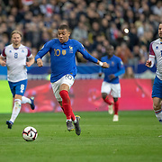 PARIS, FRANCE - March 25: Kylian Mbappé #10 of France chased by Gylfi Por Sigurdsson #10 of Iceland during the France V Iceland, 2020 European Championship Qualifying, Group Stage at  Stade de France on March 25th 2019 in Paris, France (Photo by Tim Clayton/Corbis via Getty Images)