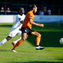 Barnets midfielder Dan Sweeney is closely shadowed by Dovers midfielder Nortei Nortey during the National League match between Dover Athletic and Barnet FC at Crabble Stadium, Kent on 1 September 2018. Photo by Matt Bristow.
