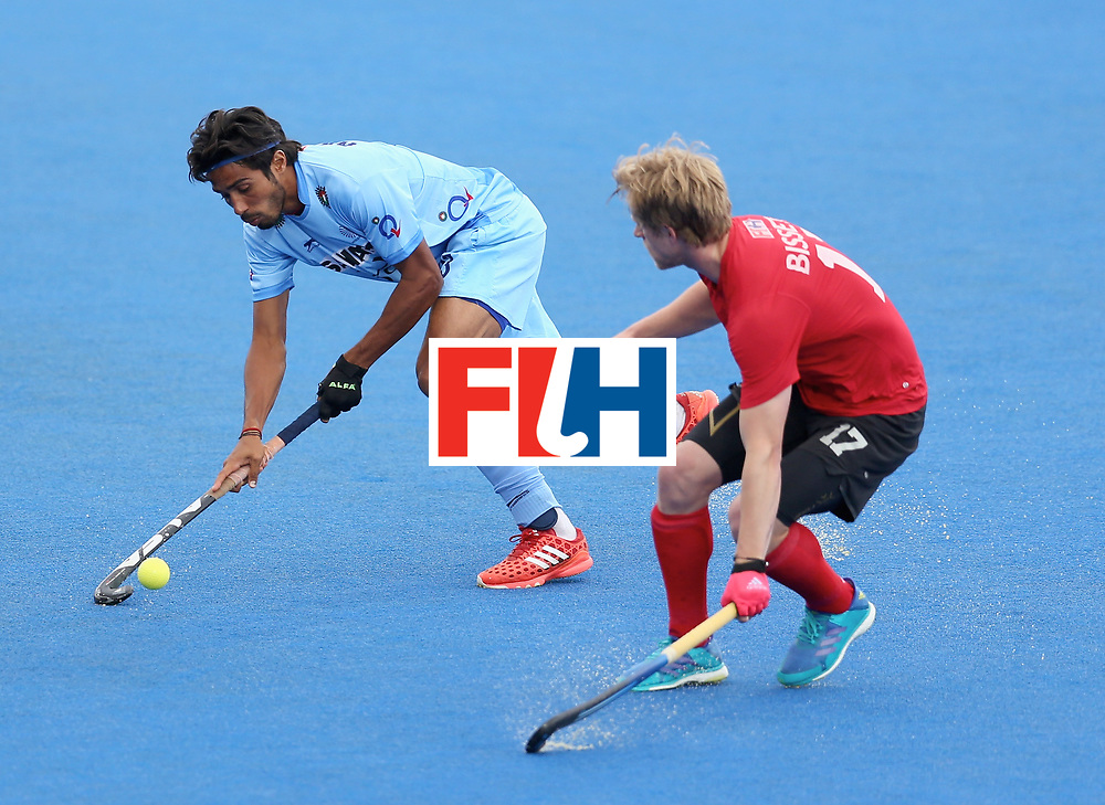LONDON, ENGLAND - JUNE 25: Pardeep Mor of India and Brenden Bissett of Canada battle for possession during the 5th/6th place match between India and Canada on day nine of the Hero Hockey World League Semi-Final at Lee Valley Hockey and Tennis Centre on June 25, 2017 in London, England. (Photo by Steve Bardens/Getty Images)