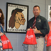 JOHN WARD/BUY AT PHOTOS.MONROECOUNTYJOURNAL.COM <br /> From left, Smithville school nurse Renee Harris and Smithville High School Principal Chad O'Brian accept emergency kits for classrooms from Access Family Health Services Executive Director Marilyn Sumerford.
