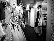 Abbigail Buchanan watches the television screen in the dressing room waiting for her time to go on stage as the porcelain doll the the Central Ohio Youth Ballet's production of the Nutcracker.