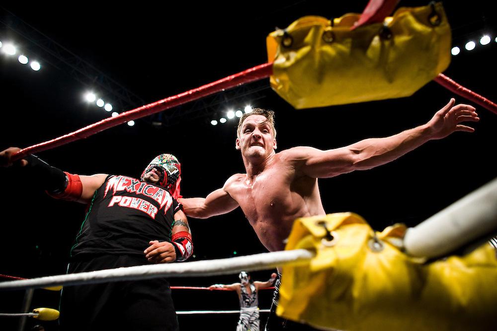 Lucha Libre AAA wrestler Jack Evans slams Crazyboy into a turnbuckle at a match in Sacramento, CA March 28, 2009.