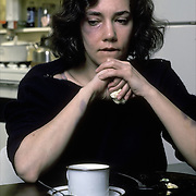 Depressed, battered and abused woman, sitting at kitchen table. Little self esteem, sees no alternative to brutual relationship, reluctant to report the abuse
