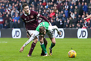 Harry Cochrane (#47) of Heart of Midlothian fouls Martin Boyle (#17) of Hibernian during the William Hill Scottish Cup 4th round match between Heart of Midlothian and Hibernian at Tynecastle Stadium, Gorgie, Scotland on 21 January 2018. Photo by Craig Doyle.