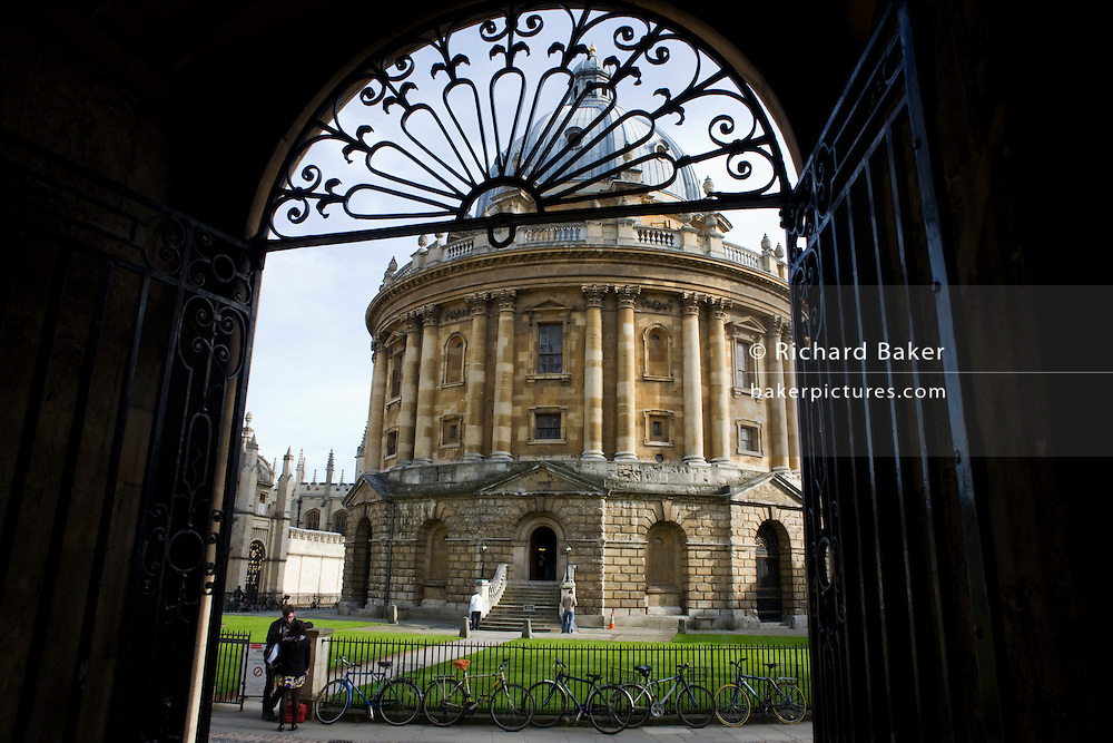 Through Oxford University's Bodleian Library arch, Radcliffe Camera is 150 feet (46 meters) above cobbled Radcliffe Square.