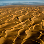 Sand dunes extend from the sea outside of Swakopmund as seen from a Scenic Air flight. Nambia boasts the world?s oldest and largest sand dunes, extending for 400 miles along the coast and more than 80 miles inland. July 16, 2008. Photo by Evelyn Hockstein for The New York Times.