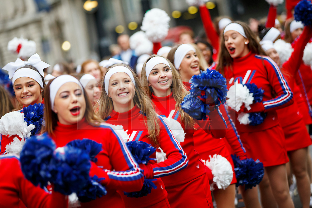 © Licensed to London News Pictures. 01/01/2017. London, UK. Cheerleaders perform in London's New Year's Day Parade on 1 January 2017 in central London. The event is one of the world's great street spectaculars with up to 10,000 performers from around the world and hosts marching bands, cheerleaders, leading companies, unions and local boroughs celebrating the arrival of 2017. Photo credit: Tolga Akmen/LNP