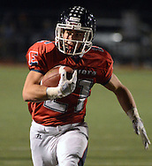 DOYLESTOWN, PA - OCTOBER 17: Central Bucks East's Alex Gibson #21 runs for a touchdown against Truman in the first quarter at War Memorial Stadium October 17, 2014 in Doylestown, Pennsylvania. (Photo by William Thomas Cain/Cain Images)