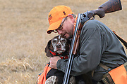 Bob St. Pierre has a heart-to-heart talk with his German Shorthair, Tram, during a late season hunt in Minnesota