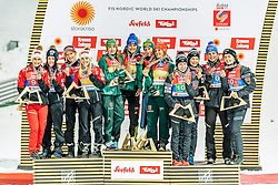 26.02.2019, Seefeld, AUT, FIS Weltmeisterschaften Ski Nordisch, Seefeld 2019, Skisprung, Damen, Siegerehrung, im Bild v.l. Silbermedaillengewinnerin Eva Pinkelnig (AUT), Jacqueline Seifriedsberger (AUT), Chiara Hoelzl (AUT), Daniela Iraschko-Stolz (AUT), Weltmeisterin und Goldmedaillengewinnerin Juliane Seyfarth (GER), Ramona Straub (GER), Carina Vogt (GER), Katharina Althaus (GER), Bronzemedaillengewinnerin Anna Odine Stroem (NOR), Ingebjoerg Saglien Braaten (NOR), Silje Opseth (NOR), Maren Lundby (NOR) // f.l. Silver medalist Eva Pinkelnig Jacqueline Seifriedsberger Chiara Hoelzl Daniela Iraschko-Stolz of Austria World champion and Gold medalist Juliane Seyfarth Ramona Straub Carina Vogt Katharina Althaus of Germany and Bronce medalist Anna Odine Stroem Ingebjoerg Saglien Braaten Silje Opseth Maren Lundby of Norway during the winner ceremony for the ladie's Skijumping HS109 competition of FIS Nordic Ski World Championships 2019. Seefeld, Austria on 2019/02/26. EXPA Pictures © 2019, PhotoCredit: EXPA/ Stefan Adelsberger