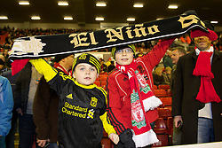 LIVERPOOL, ENGLAND - Wednesday, December 15, 2010: Two young Liverpool supporters before the UEFA Europa League Group K match against FC Utrecht at Anfield. Under-16's were allowed in for free with adults. (Photo by: David Rawcliffe/Propaganda)