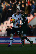 Tottenham Hotspur striker Harry Kane walks off the field with the match ball and Tottenham Hotspur goalkeeper Hugo Lloris after the Barclays Premier League match between Bournemouth and Tottenham Hotspur at the Goldsands Stadium, Bournemouth, England on 25 October 2015. Photo by Mark Davies.