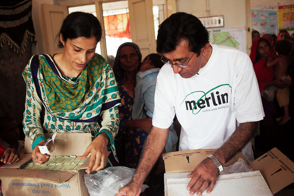 Shameem Akhtar, a Merlin lady health visitor with Doctor Muhammad Afzal, Project Medical Coordinator working at the government health centre in Mitho Barbar, Dadu, Thatta, Sindh, Pakistan on July 4, 2011.