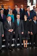 20.10.2018. Copenhagen, Denmark.  <br /> The Prime Minister of Denmark Lars Lokke Rasmussen (L) Crown Prince Frederik  (C) Crown Princess Mary (R) pose for a family picture during the P4G Copenhagen Summit 2018 at The Danish Radio Concert Hall.<br /> Photo: © Ricardo Ramirez