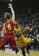 December 09 2010: Iowa guard Kachine Alexander (21) puts up a shot by Iowa St. forward Hallie Christofferson (5) during the first half of their NCAA basketball game at Carver-Hawkeye Arena in Iowa City, Iowa on December 9, 2010. Iowa defeated Iowa State 62-40 in the Hy-Vee Cy-Hawk Series rivalry game.