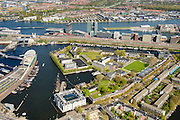 Nederland, Noord-Holland, Amsterdam, 09-04-2014;<br /> Het Marineterrein, Kattenburg en het Scheepvaartmuseum, links de IJtunnel en museum Nemo met historische woonboten. Boven Amsterdam-Noord, het IJ, Java-eiland en de Piet Heinkade, spoorbaan.<br /> Navy area (center) and the National Maritime Museum (white building), left Museum Nemo, railroad, newly constructed buildings.  The North of Amsterdam (top). <br /> luchtfoto (toeslag op standard tarieven);<br /> aerial photo (additional fee required);<br /> copyright foto/photo Siebe Swart