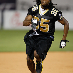 Apr 28, 2010; Metairie, LA, USA; Reggie Jones (35) runs to third base during the Heath Evans Foundation charity softball game featuring teammates of the Super Bowl XLIV Champion New Orleans Saints at Zephyrs Field.  Mandatory Credit: Derick E. Hingle-US-PRESSWIRE.