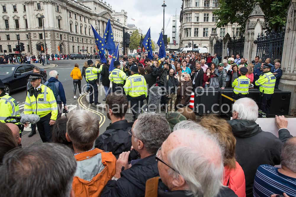 "London, UK. 25 September, 2019. Pro- and anti-Brexit activists protest outside the Houses of Parliament on the day after the Supreme Court ruled that the Prime Minister's decision to suspend parliament was ""unlawful, void and of no effect""."