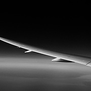 787 Dreamliner wing heading East over the Great Lakes in Canada