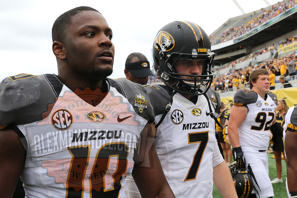 ORLANDO, FL - JANUARY 01: Kentrell Brothers #10 and Maty Mauk #7 of the Missouri Tigers walk off the field at halftime during the Buffalo Wild Wings Citrus Bowl against the Minnesota Golden Gophers at the Florida Citrus Bowl on January 1, 2015 in Orlando, Florida. (Photo by Alex Menendez/Getty Images) *** Local Caption *** Kentrell Brothers; Maty Mauk