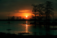 Winter sun sets over lake in Venice, LA.  Copyright 2011 Reid McNally