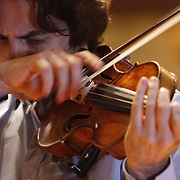 Russian born American violinist Philippe Quint plays Vieuxtemps Guarneri del Ges violin of 1741 in a solo recording performance in the Rudolph Ganz Hall of the Roosevelt University in Chicago June 6, 2010.<br />Photography by  Jose  More