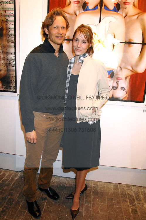 Actress GEORGIE RYLANCE and DR GREG BAILEY at the launch of 'Glenmorangie 5 Senses' an exhibition of photographs by Mike Figgis held at Proud Camden, Stables Market, London NW1 on 13th May 2008.<br />
