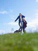 Two senior men goofing around in park