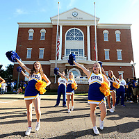 Tupelo High School Cheerleaders get the pep rally started at Fairpark after the THS Homecoming Parade Thursday afternoon in Tupelo.
