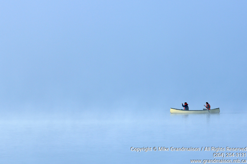 Canoeing in fog on Lake of Two Rivers<br />