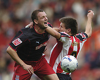 Photo: Jonathan Butler.<br />Southampton v Stoke City. Coca Cola Championship. 21/10/2006.<br />Grzegorz Rasiak of Southampton is out jumped by Clint Hill of Stoke.