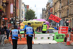 © Licensed to London News Pictures. 31/08/2019. Manchester, UK. Extinction Rebellion block roads around Deansgate in Manchester City Centre , during days of planned disruption organised by environmental campaigners . Manchester City Council has declared a climate emergency but activists say the council's development plans do not reflect this . Photo credit: Joel Goodman/LNP