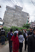 Devastating April 2015 Nepal Earthquake. Panga Village, Kirtipur, Kathmandu Valley, a few hours after the earthquake struck. People watching one of the collapsed buildings in the village. More than a third of the houses in Panga were destroyed, most of them old traditional houses made of brick.