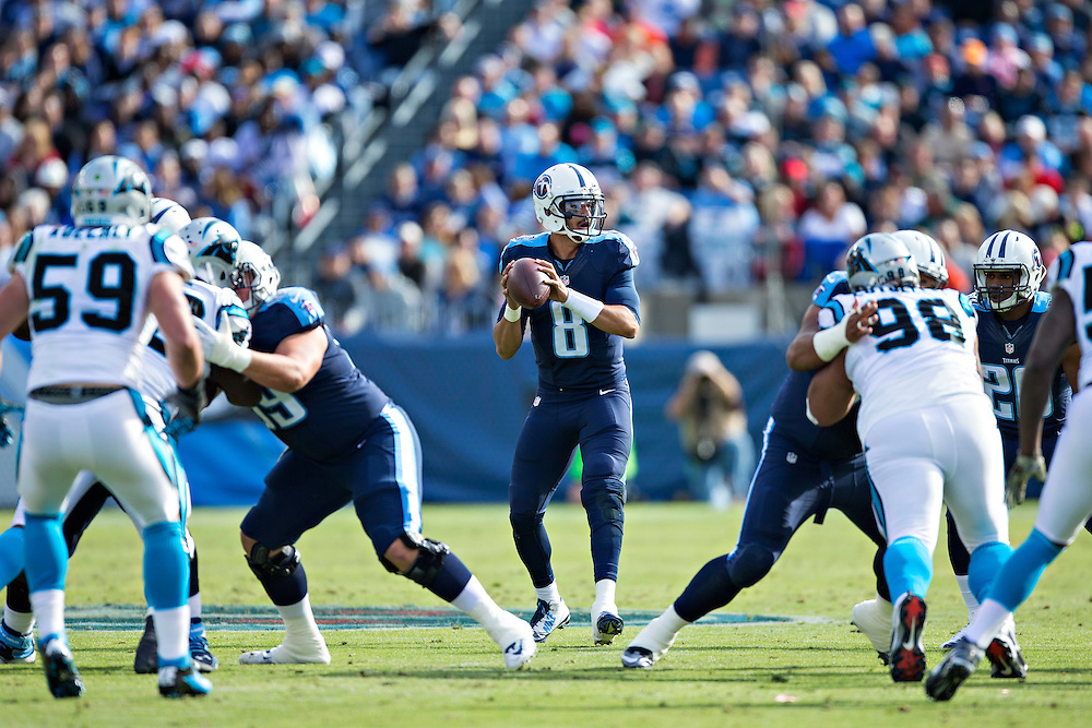 NASHVILLE, TN - NOVEMBER 15:  Marcus Mariota #8 of the Tennessee Titans looking downfield for a receiver during a game against the Carolina Panthers at Nissan Stadium on November 15, 2015 in Nashville, Tennessee.  (Photo by Wesley Hitt/Getty Images) *** Local Caption *** Marcus Mariota