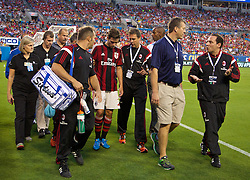 CHARLOTTE, USA - Saturday, August 2, 2014: AC Milan's Mattia De Sciglio walks off injured during the International Champions Cup Group B match against Liverpool at the Bank of America Stadium on day thirteen of the club's USA Tour. (Pic by David Rawcliffe/Propaganda)
