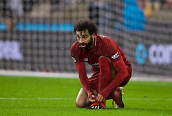 WOLVERHAMPTON, ENGLAND - Friday, December 21, 2018: Liverpool's Mohamed Salah ties his boot lace during the FA Premier League match between Wolverhampton Wanderers FC and Liverpool FC at Molineux Stadium. (Pic by David Rawcliffe/Propaganda)