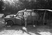Taximan by his car, at Glastonbury, 1989.