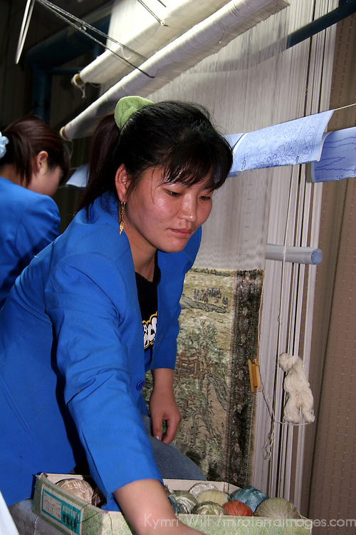 Asia, China, Beijing. Chinese silk carpet weaver.