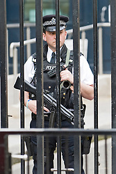 © licensed to London News Pictures. 16/05/2011. London, UK . Armed police stand on the front gates at Downing Street today (16/05/2011) following reports of  a bomb scare in central London. The warning is thought to be related to Irish dissident republicans. Please see special instructions for usage rates. Photo credit should read Ben Cawthra/LNP