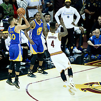 09 June 2017: Golden State Warriors guard Stephen Curry (30) takes a jump shot over Cleveland Cavaliers guard Iman Shumpert (4) during the Cleveland Cavaliers 137-11 victory over the Golden State Warriors, in game 4 of the 2017 NBA Finals, at  the Quicken Loans Arena, Cleveland, Ohio, USA.