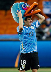 Andres Scotti of Uruguay celebrates after penalty shots at the 2010 FIFA World Cup South Africa Quarter Finals football match between Uruguay and Ghana on July 02, 2010 at Soccer City Stadium in Sowetto, suburb of Johannesburg. (Photo by Vid Ponikvar / Sportida)