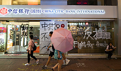 Hong Kong. 6 October 2019. Tens of thousands of pro-democracy protestors march in pouring rain through centre of Hong Kong today from Causeway Bay to Central. Peaceful march later turned violent as a hard-core of protestors confronted police. Pic; Vandalised China Citic  Bank branch in Causeway Bay. Iain Masterton/Alamy Live News.