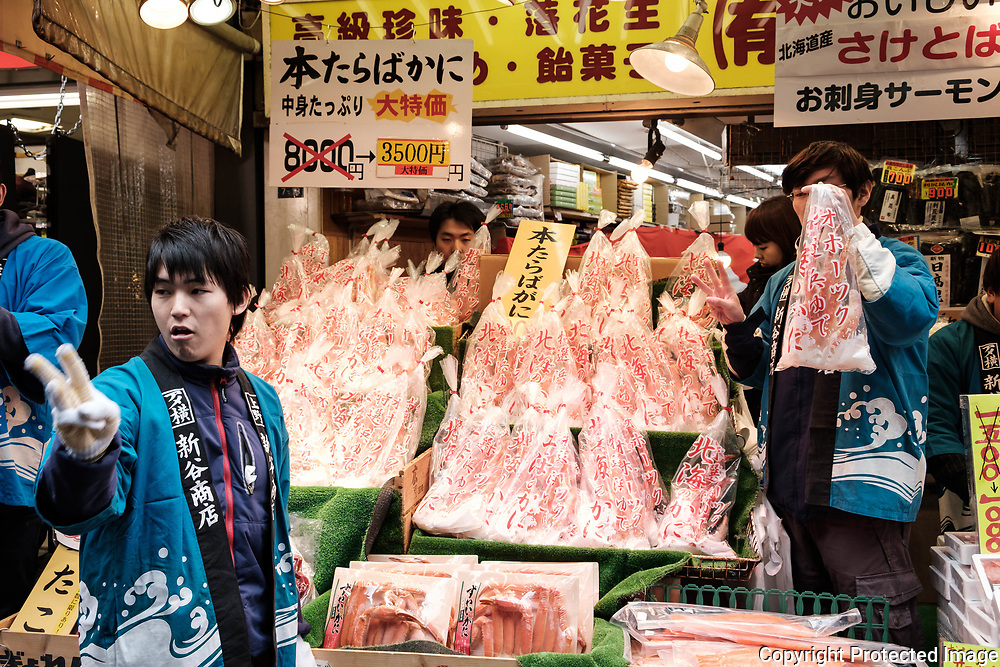"Crab merchants present their products to customers at the Ameyoko market, Ueno in Tokyo Sunday, Dec. 31, 2017. Ameyoko market is crowded by shoppers who look for discounts on ingredients for ""osechi"" or Japanese traditional New Year dishes. 31/12/2017-Tokyo, JAPAN"