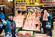 """Crab merchants present their products to customers at the Ameyoko market, Ueno in Tokyo Sunday, Dec. 31, 2017. Ameyoko market is crowded by shoppers who look for discounts on ingredients for """"osechi"""" or Japanese traditional New Year dishes. 31/12/2017-Tokyo, JAPAN"""