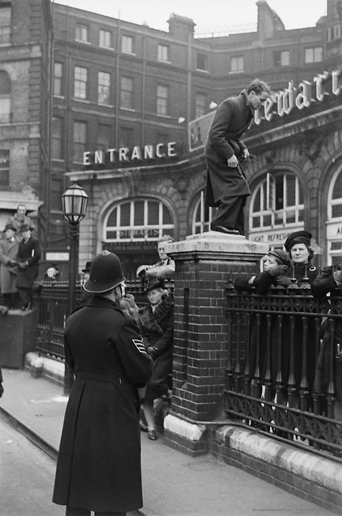 People Clambering Over Fence, London, England, 1945