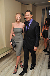 DAVID WALLIAMS and his wife LARA STONE at the second night of the Tomodachi (Friends) Charity Dinners hosted by Chef Nobu Matsuhisa in aid of the Japanese committee for UNICEF held at Nobu Berkeley, Berkeley Street, London on 5th May 2011.